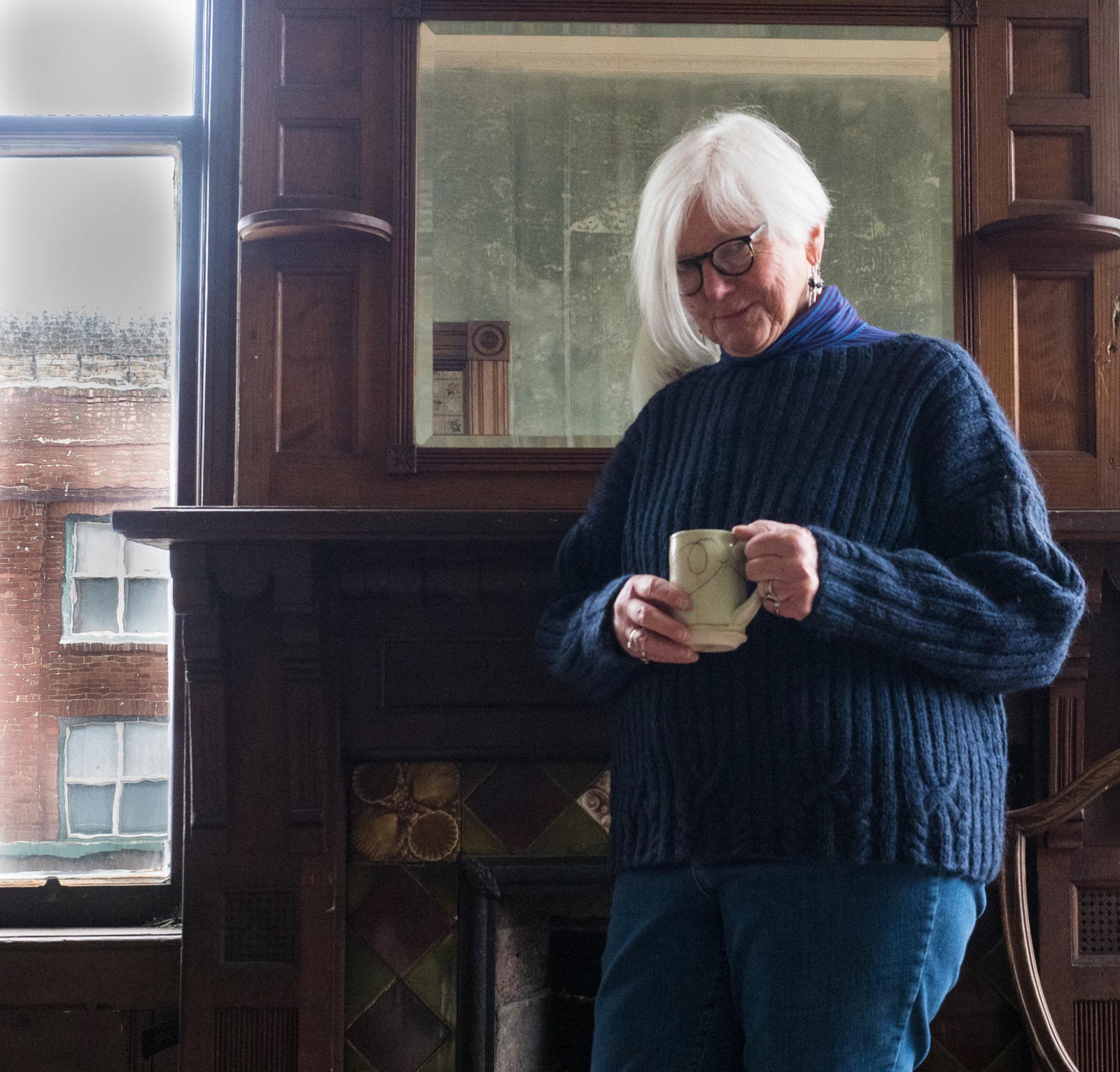 Falt lady smirking with cup.